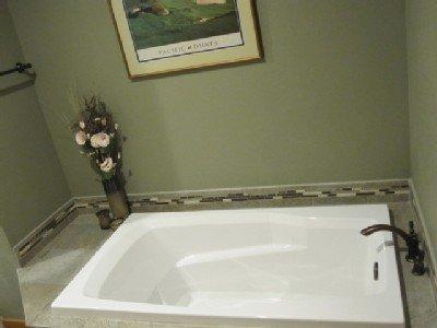 Mashie y Brassie habitaciones compartidas tina de baño