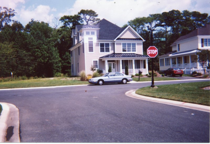 Front View of Home with long driveway and 2 car garage in back