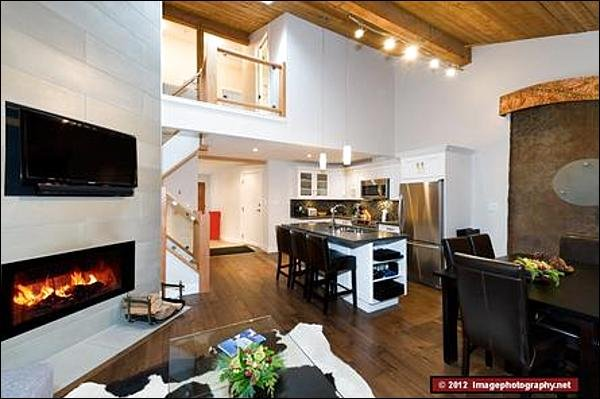 The Living Area Features a Beautiful Fireplace and a Large LCD TV