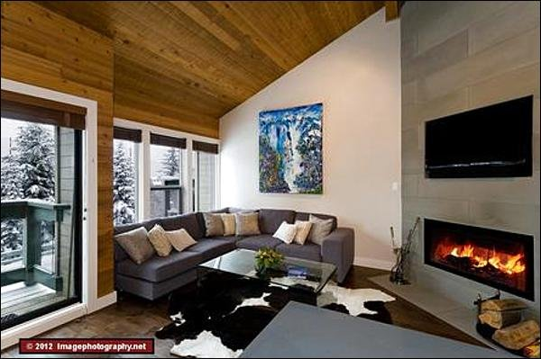 The Living Area is Spacious with Large Picturesque Windows