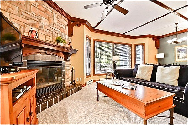 The Welcoming Living Area Offering you a Stone Fireplace and a Flat Screen TV