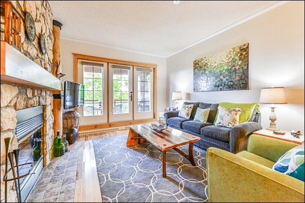 Spacious Living Room with Large Flat Screen TV, Beautiful Fireplace and Sleeper Sofa