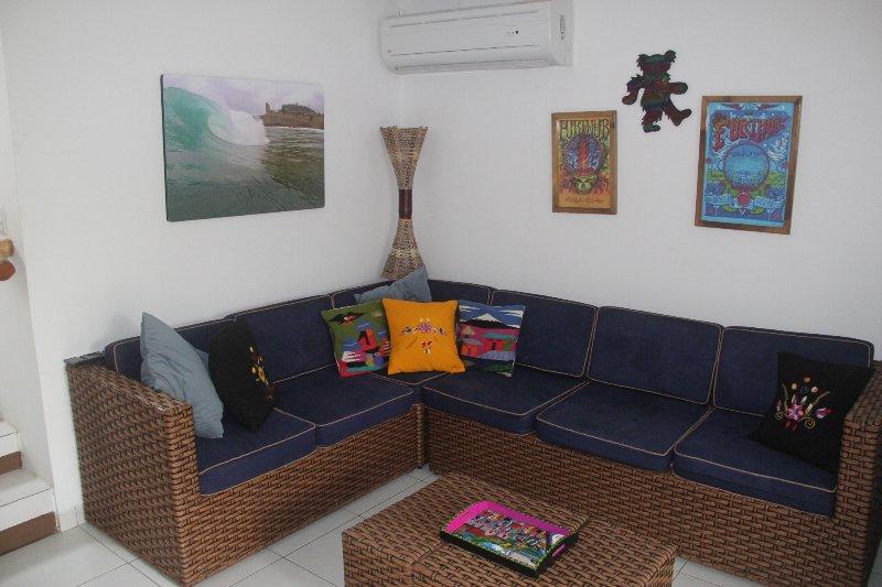living room, split unit on the wall