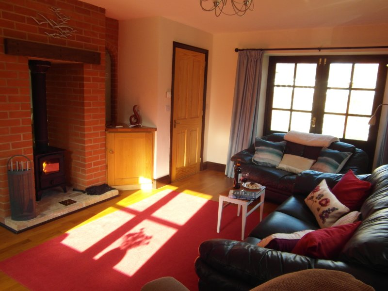 Sunny lounge with underfloor heating & wood stove. Everyone loves the massage riser recliner chair