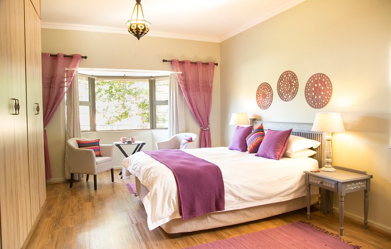 Main bedroom with a view and private seating.