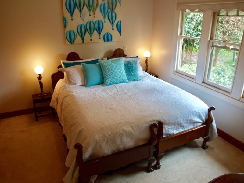 The first bedroom boast a super comfortable king size bed and a peaceful garden view