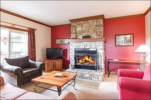 Lovely Living Room with Stone Wood Burning Fireplace