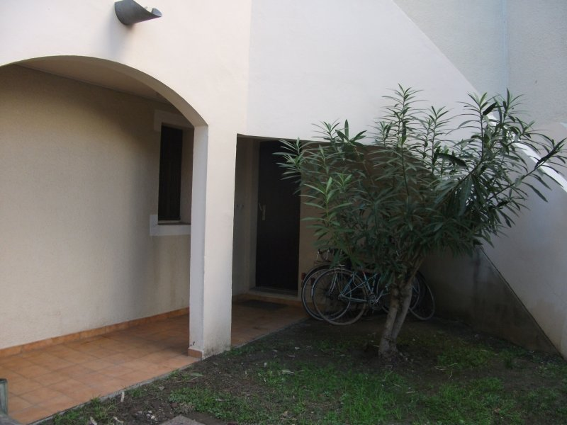 front door with the bicycle shed under the stairs