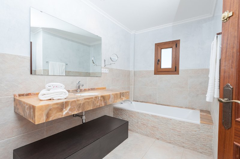 The Master en-suite bathroom with bathtub and shower