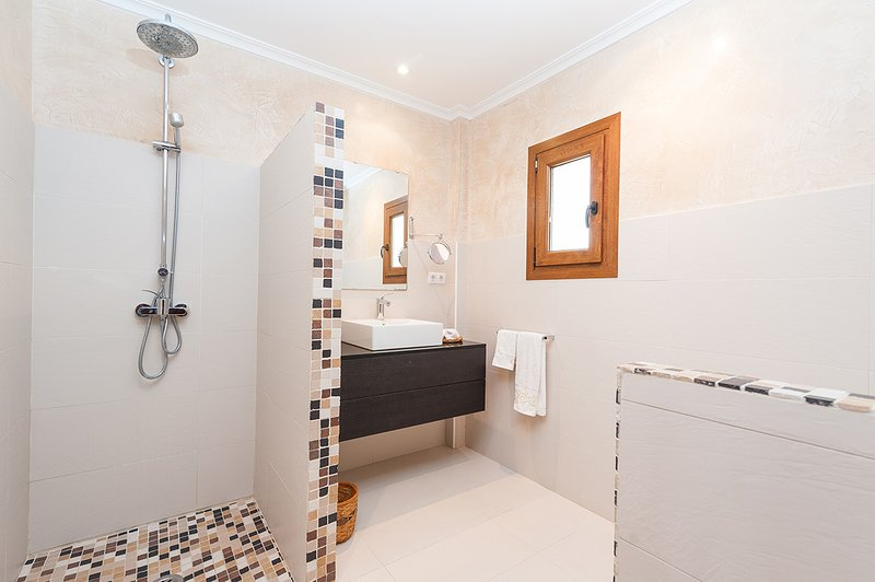 Family bathroom with a shower