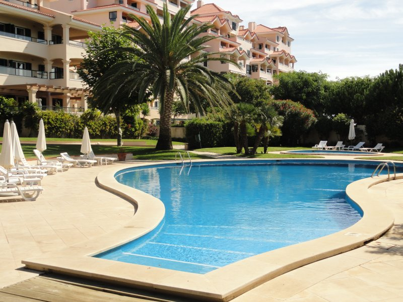 Main Swimming Pool and Children Pool with Sunbeds and Parasol