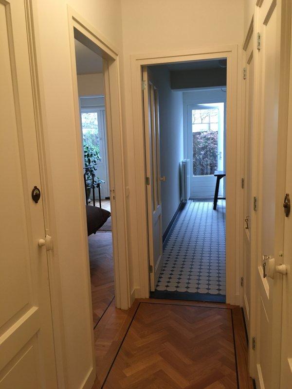 corridor, doors clockwise: bathroom, bedroom, kitchen, closet, toilet