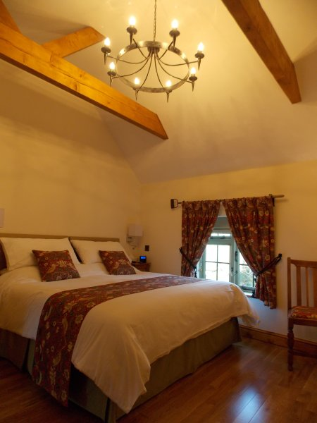 The bedroom at Crafty Cottage, 10ft high vaulted ceiling and 6ft super king bed  USA King