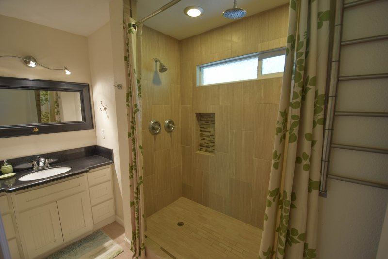 Master bathroom has 7 foot shower with 2 shower heads and built-in bench