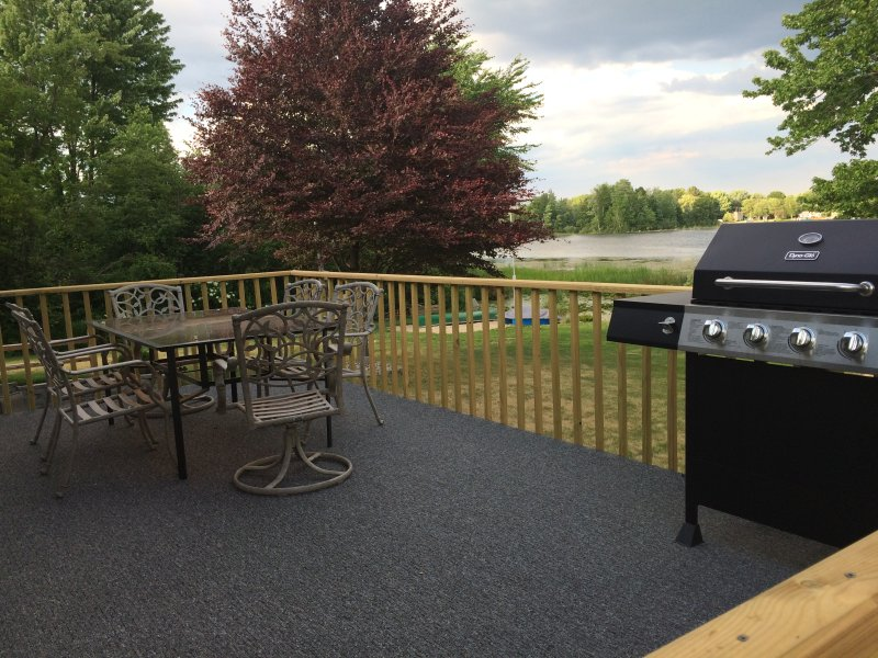 Deck with table and gas grill