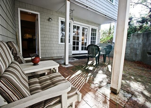 Private brick courtyard with a patio table for 4 and gas BBQ