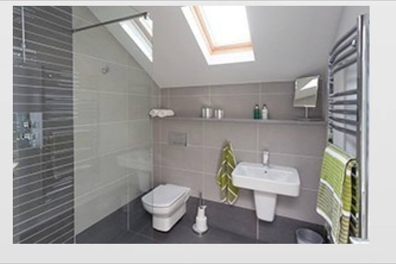 Ensuite bathroom with walk in shower and complementary toiletries.