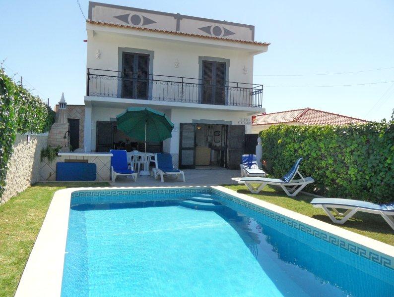 Garden, pool and Villa facade