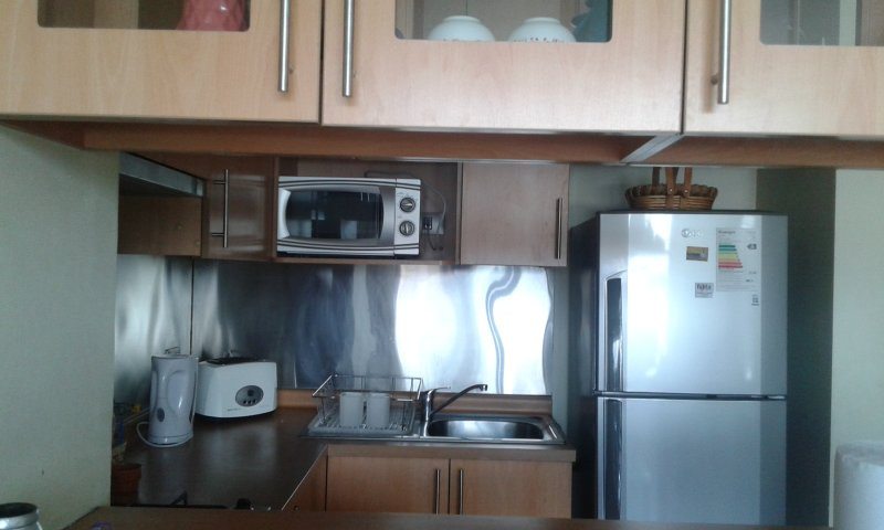 Our kitchen has a microwave, refrigerator, toaster, kettle and all utensils.