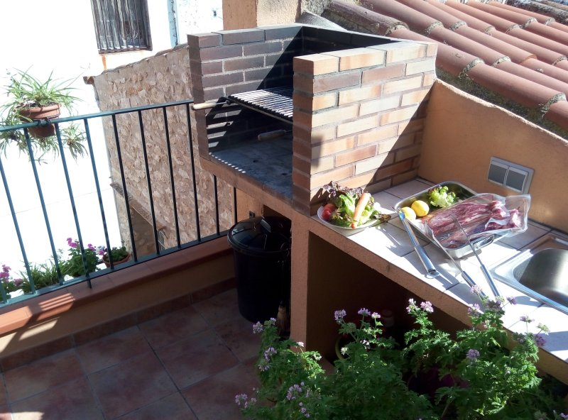 The BBQ next to the upstairs terrace.