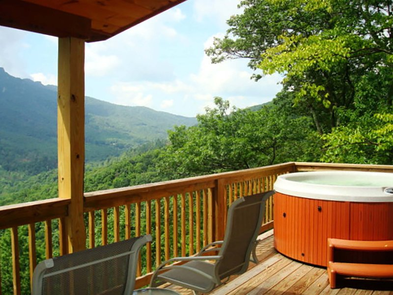 Hot tub on the deck with mountain views