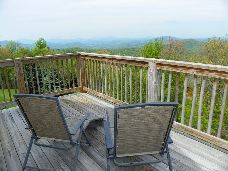 Back deck with chairs and mountain views