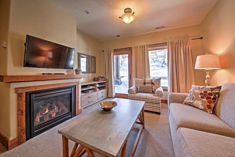 Warm up by the fireplace at this 2-bedroom, 2-bath vacation rental in Whitefish!
