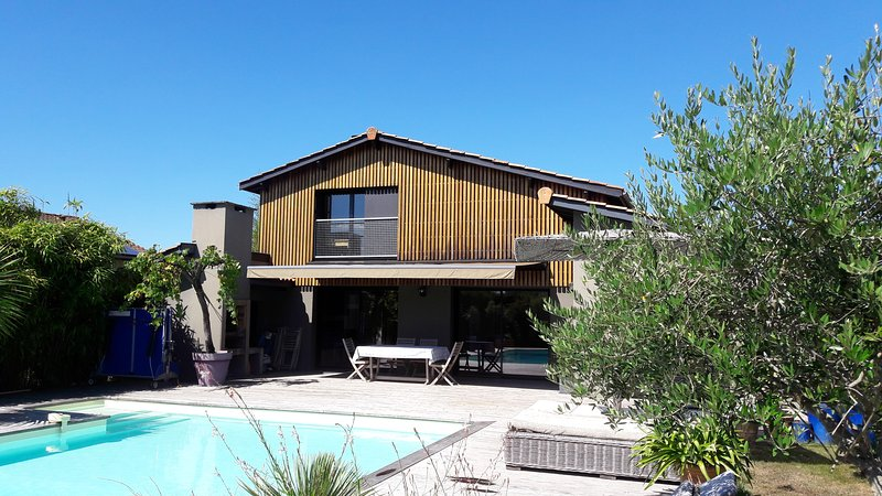South side of house with pool,, decking, outside dining area and barbecue.