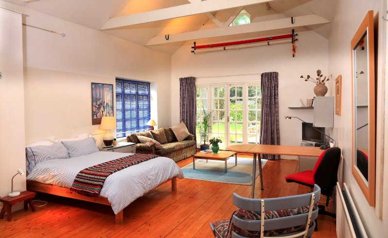 Hugh Studio,  spacious and quiet with  living area , Internet, TV , and access to our garden.