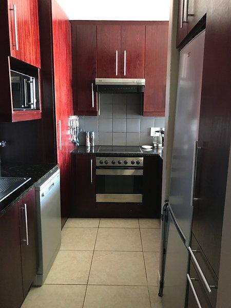 Open plan kitchen with oven-stove-microwave-dishwasher-washing machine-fridage freezer