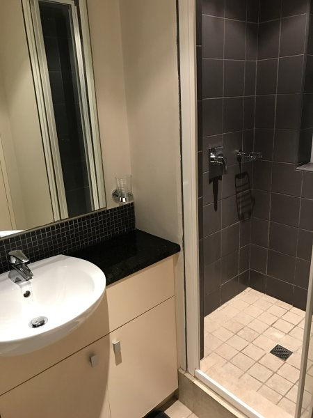 Second bathroom with shower- basin- toilet