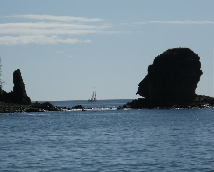 Peaceful Gorilla Head Rock from the pebble beach surrounding Paradise Bay