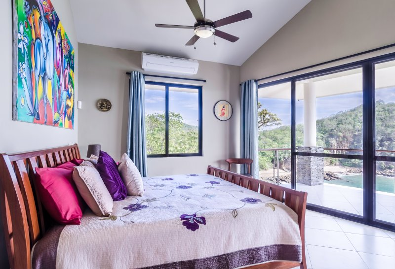 Upstairs master BR-1 with ocean and bay views, king bed, AC and outdoor shower