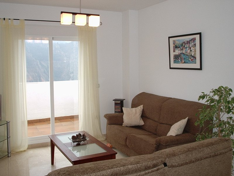 sala de estar con salida a la terraza