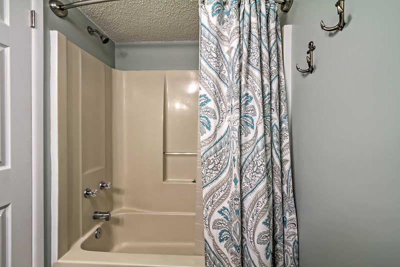 Bathroom offers a shower/tub combo.