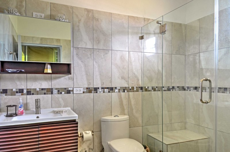 The master bathroom features a tile-lined shower.