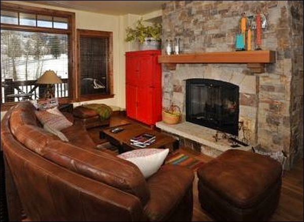 Cozy up on the leather couches in front of the fire.