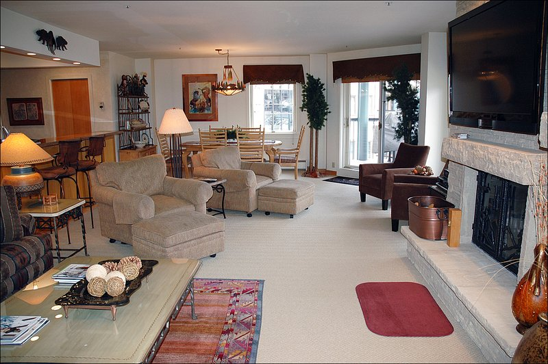 Enjoy the Large Flat Screen TV and Wood Burning Fireplace in the Living Room