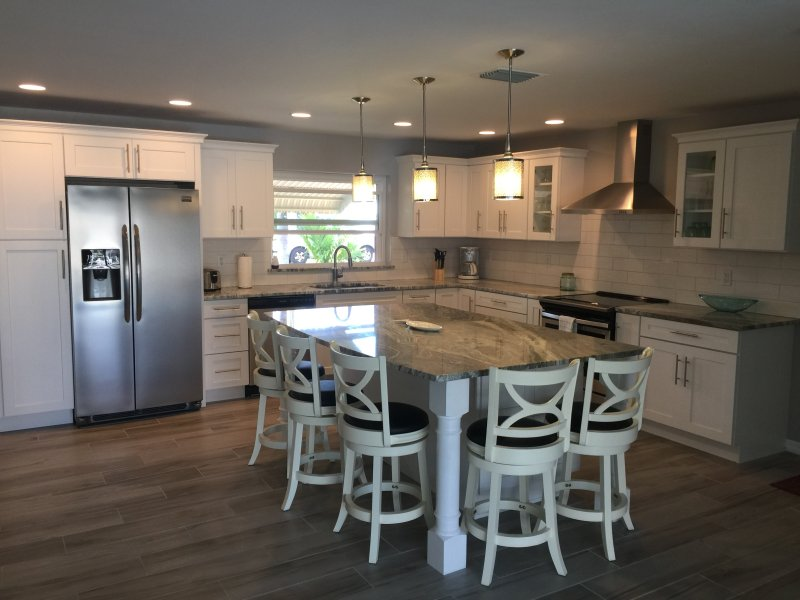 Spacious modern kitchen with granite counters and large center island perfect for entertaining.