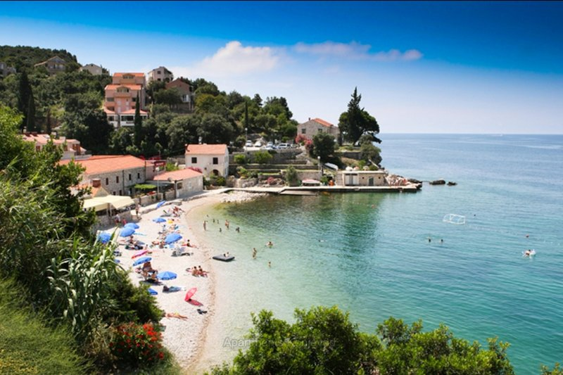 This shallow water pebble beach with cafes and restaurants is just 3 min walk away from the house