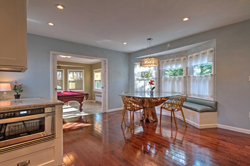 The kitchen also features a breakfast nook and wet bar.