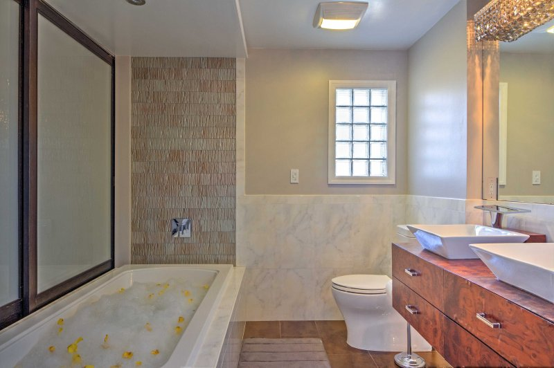 The master bathroom features a jetted tub and steam shower.