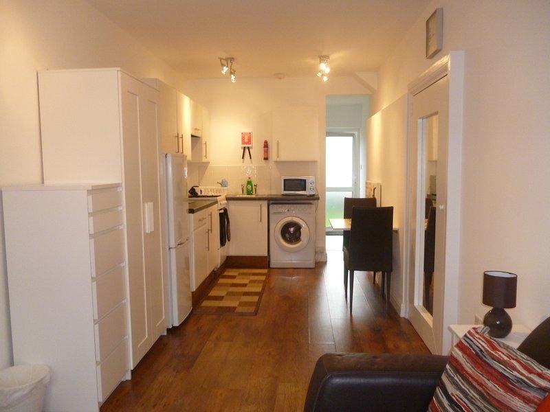 Overview of open plan studio apartment.