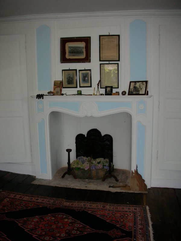 Fireplace in upstairs bedroom.