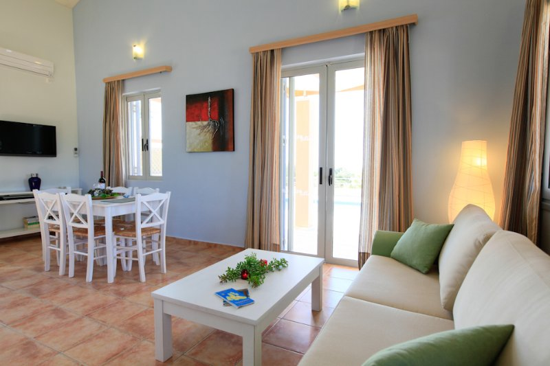 Open plan living/dining area with WiFi, TV, DVD player and terrace access
