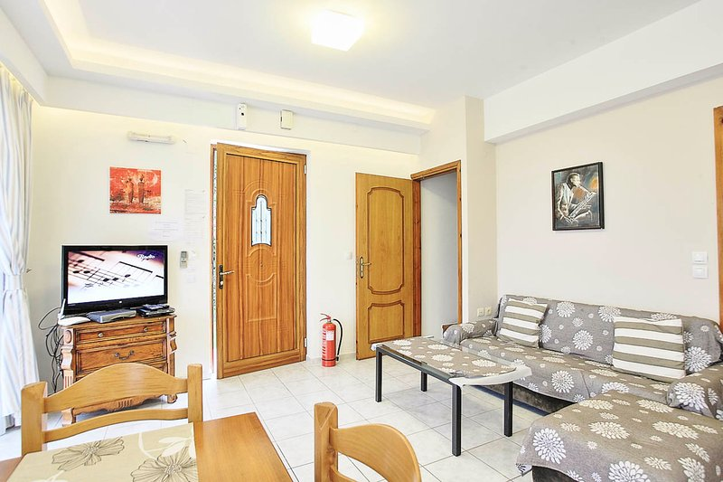 Open plan living area with WiFi, TV and DVD player