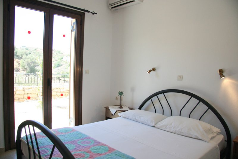 Double bedroom with A/C and balcony access