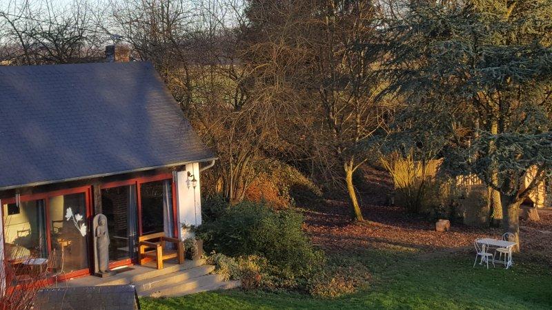 """habitación de invitados independiente con chimenea y sala de estar """"madera"""""""