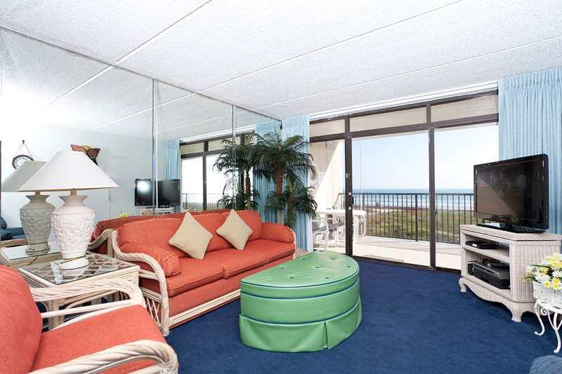 Updated living area with a beach view