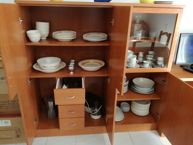 Dishes in dining room furniture.